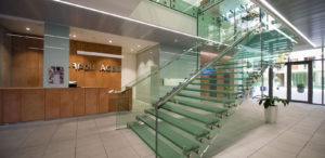 AGBU Armenia building's lobby which extends into a glass enclosed courtyard.